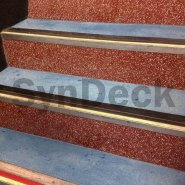 In Progress SynDeck Epoxy System with Flake in Red, showing Bond Coat with Underlayment on Ferry Stairs