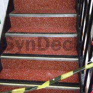 In Progress SynDeck Epoxy System with Flake in Red on Ferry Stairs