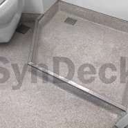 Completed SynDeck Ultra Lightweight Terrazzo System in Cotton Seed on Ship Shower/Head